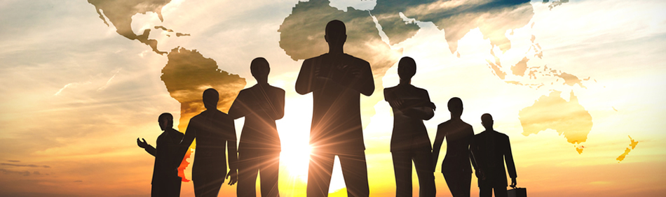Business people silhouetted against sunrise